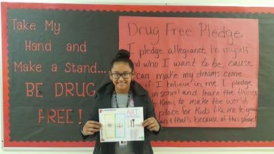 Student wins poster contest by showcasing art as a 'natural high'
