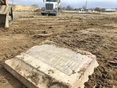 Home builders find headstone at construction site