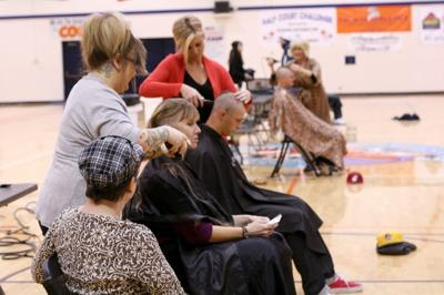 Buzz-cut-a-palooza shows support for Cory Holm