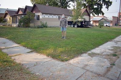 Resident sees cracks in sidewalk program