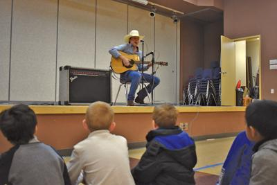 American Idol contender performs for students