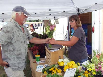 Snapping up flowers at farmers market