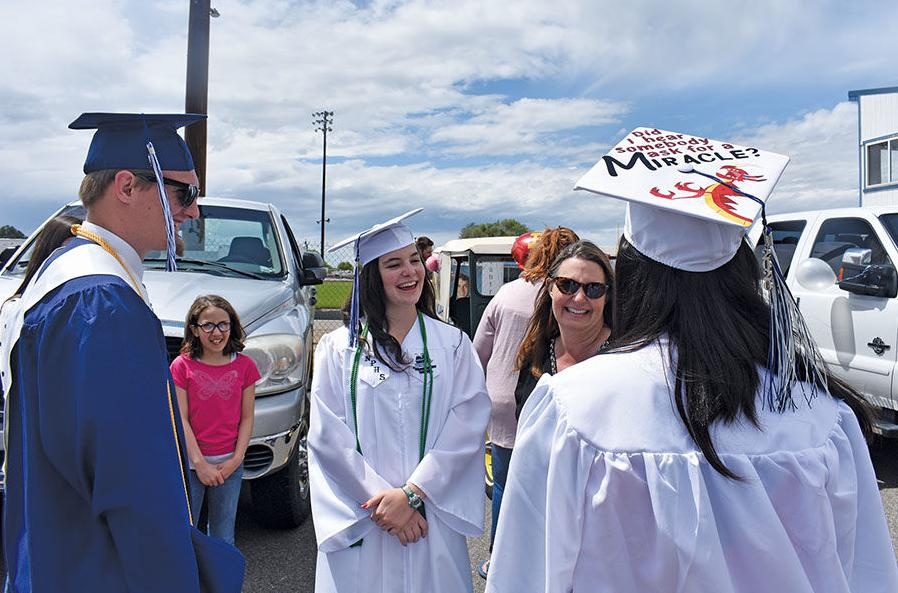 Taking it to the street: Pilgrims' graduation, parade fills downtown streets