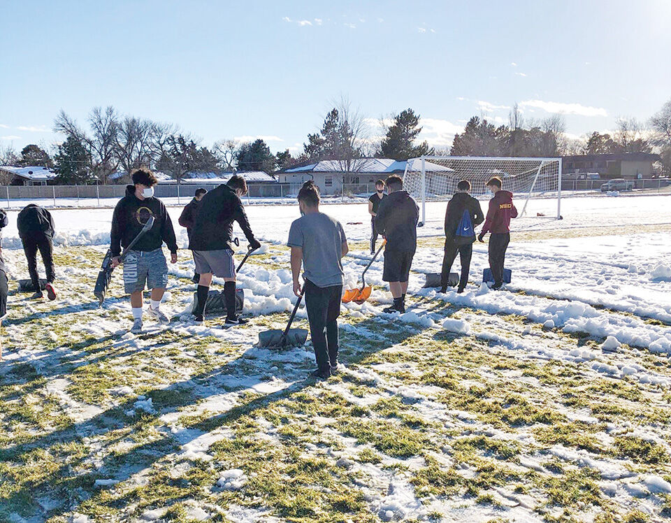 Shoveling snow off soccer fields