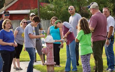 Hydrant helpers: Volunteers repaint fire hydrants after citizen's complaint on social media