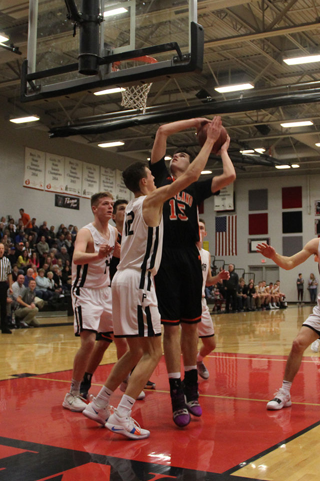 Grizzlies hold on late, beat Parma 54-47