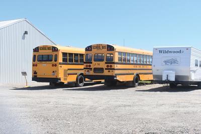District cleans house on surplus supplies, bus fleet