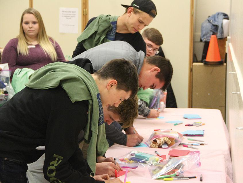 Kits packed with care: Volunteer group finds hands-on helpers at annual student summit