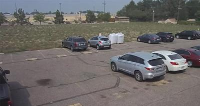 Passerby's vehicle hit in shooting behind Albertsons