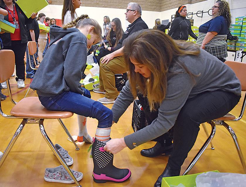 Giving winter the boot: New campaign provides all Westside Elementary students a new pair of boots
