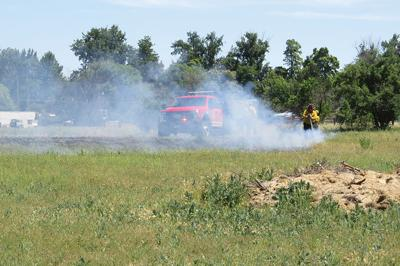 Crews put out grass fire in town