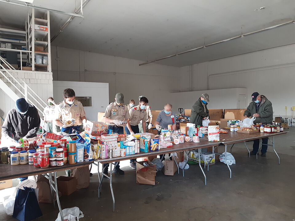 Volunteers deliver, sort collections from food drive