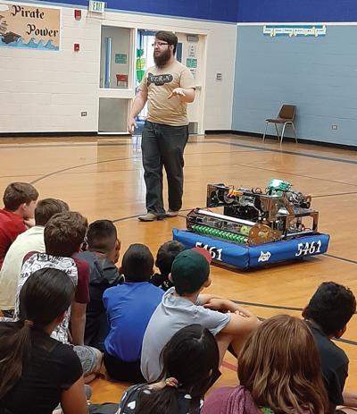 Payette STEM Camp students enjoy a visit from Henry, a First Robotics high school robot