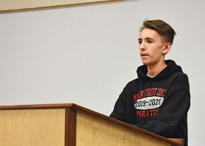 Student body president tells board that dress code 'has taken away … self-expression'
