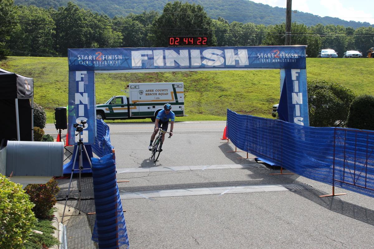 Chuck Mantooth crosses finish line