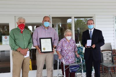 Commissioners and Governor volunteer service award winner