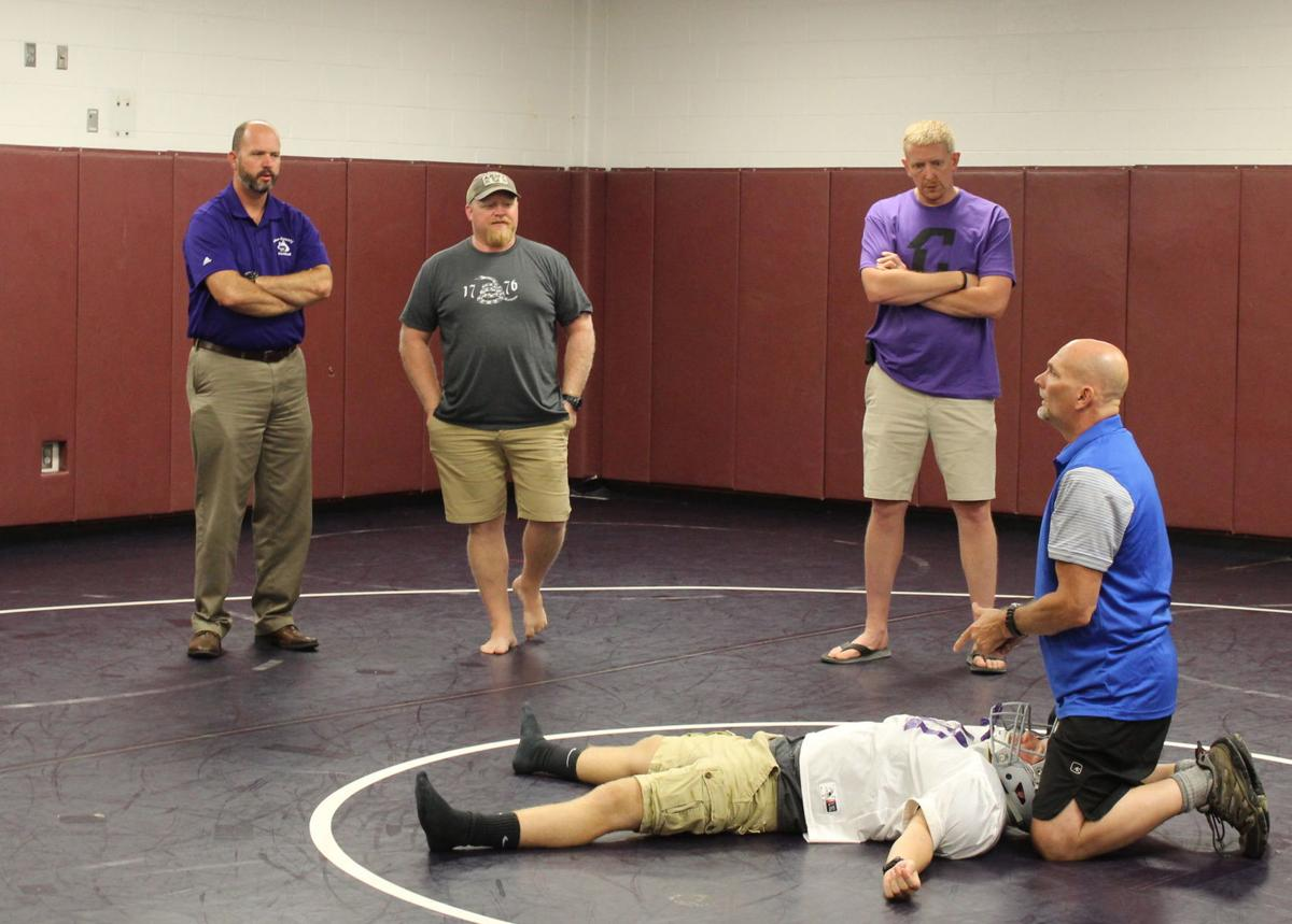 Coaches learn about how to handle an injured player