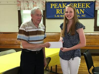 Anna Carpenter receiving the $1,000 scholarship.