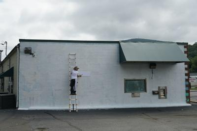 Pipes preps Imagination Ashe mural site