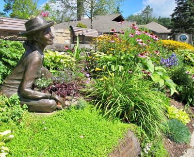 The Gardener on Main Street in Blowing Rock, looks for a spot for just one more plant.