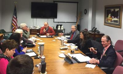 Ballard, Russell meet with commissioners