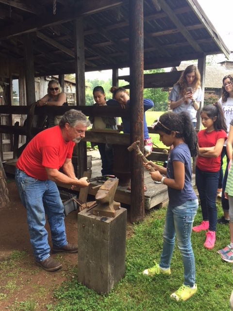 Blacksmith Dink Tharpe hosts a hands-on demonstration of blacksmithing at a past festival.