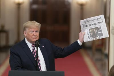 Trump with a newspaper