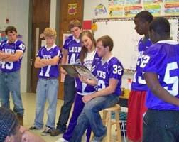 Football Players and Cheerleaders Read to Wilmot, Portland Students
