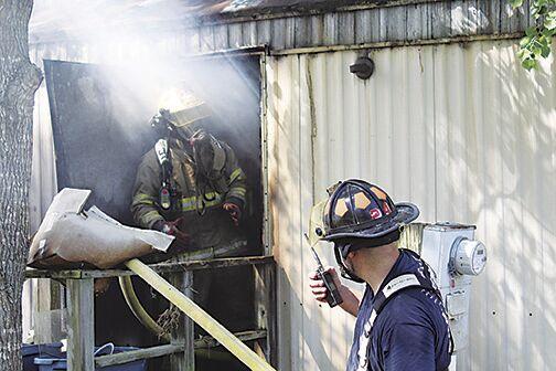 Firefighters enter burning house in West Crossett