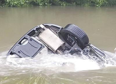 Driver escapes car submerged after hydroplane