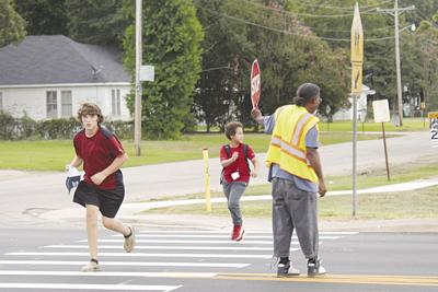 Crossing the street with aid of crossing guard