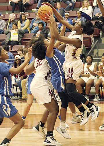 Jaylynn Hampton goes for a rebound