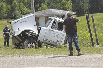 Log truck wrecks on U.S. 82