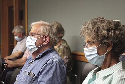 Residents wear masks after order