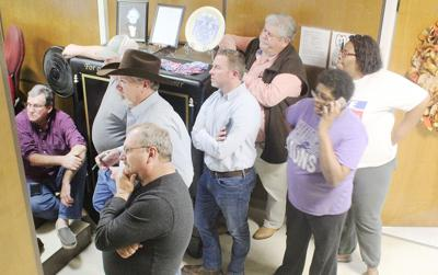 Candidates and supporters wait for poll results