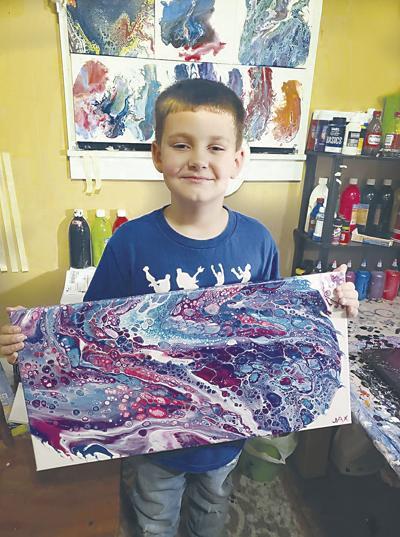 Jaxon Andrews displays painting