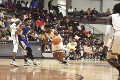 Derrick Luckey goes up the middle for shot