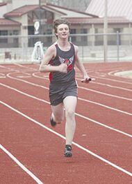 Runner finishing last leg of relay