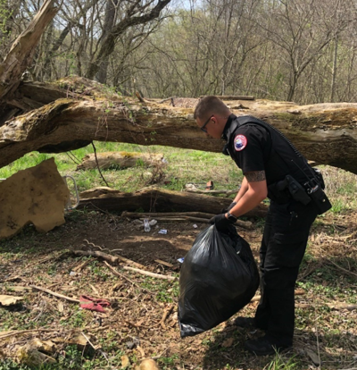 Nelsonville officer cleans up trash