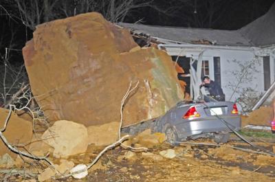 Boulder smashes Fort Street home