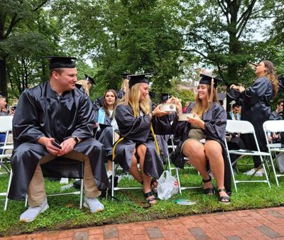 Students eat ginger during graduation