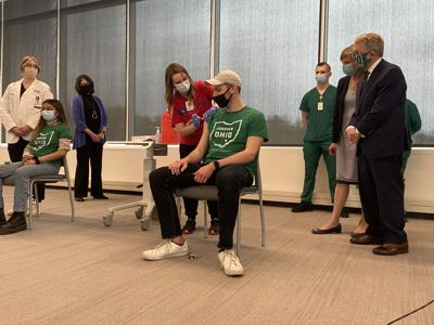 DeWine watches Ohio University student be vaccinated