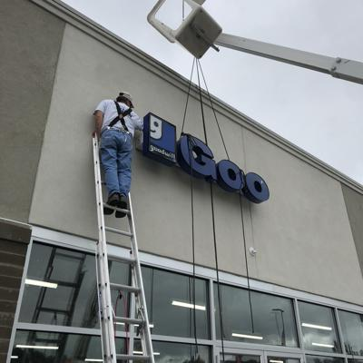 Workers mount new Goodwill sign