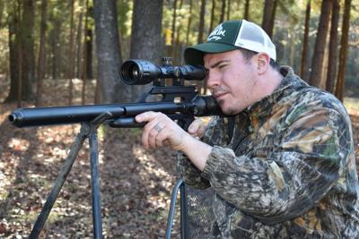 Drew Clayton aiming rifle