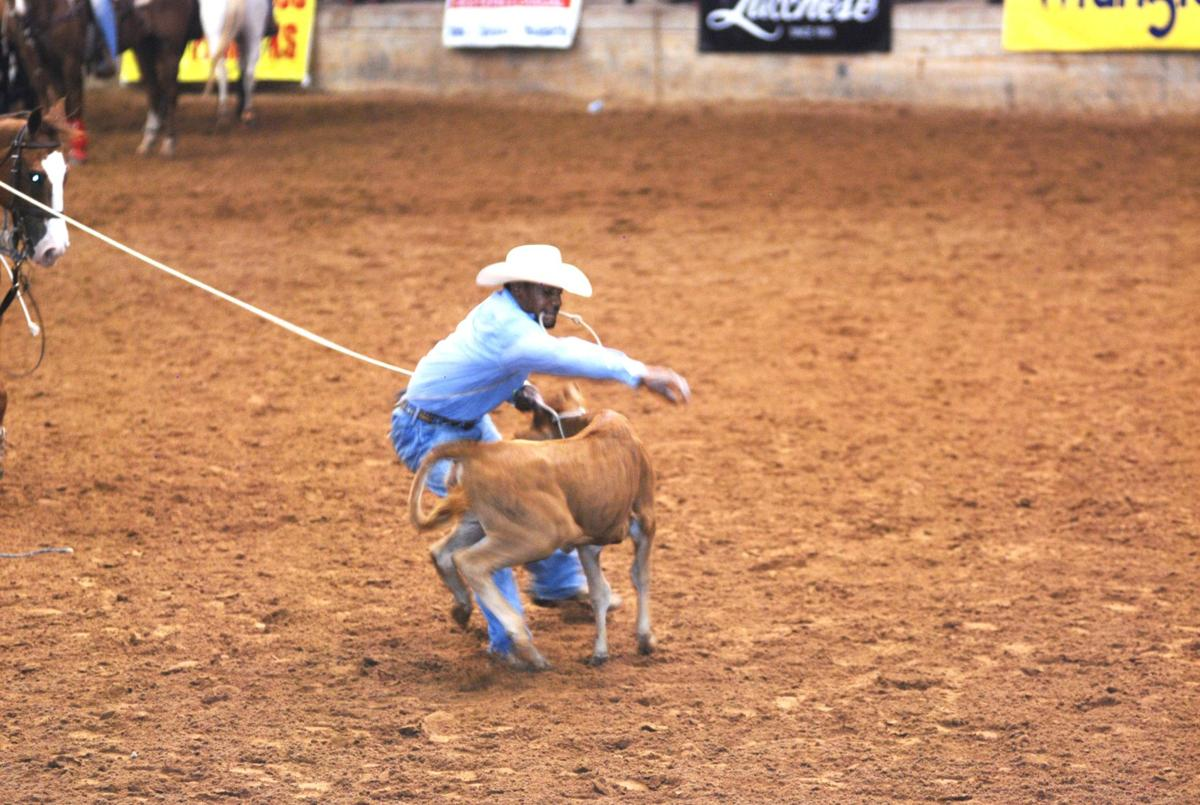 Black rodeo calf roper.jpg
