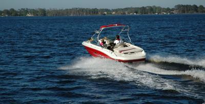 Boat running on lake
