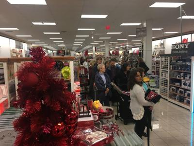 5d0a9fc1f103 Hundreds of people wait in line at Kohl s in Aurelius on Black Friday in  2016.