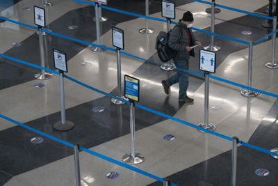 A traveler makes his way through a security line Nov. 29, 2020, in Terminal 3 at O'Hare International Airport in Chicago.