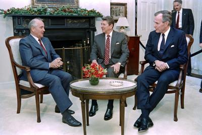 Soviet leader Mikhail Gorbachev, left, talks to President Ronald Reagan, middle, and President-elect George Bush, right, on December 7, 1988.