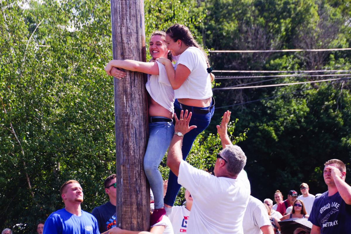 Greased pole climb draws crowd to 72nd Jordan Fall Festival